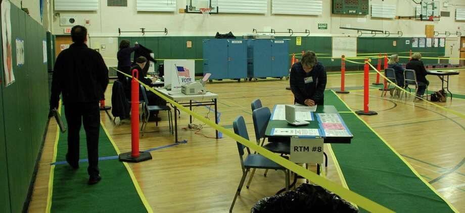 Voting in Westport's municipal election got underway at 6 a.m. Tuesday across town. Here, early-bird voters at the polling stations at Coleytown Middle School. Photo: Jarret Liotta / Westport News contributed