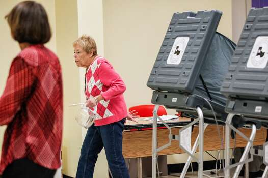 Voting gets underway early Tuesday at Houston's Metropolitan multi-service center. Photo: Johnny Hanson, Houston Chronicle