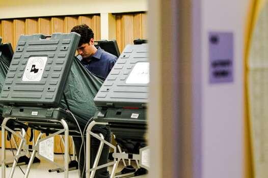 Tom Mysz votes early Tuesday at the Metropolitan Multi-Service Center. Photo: Johnny Hanson, Houston Chronicle