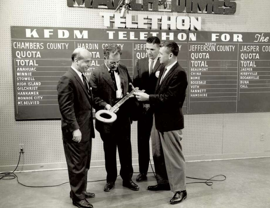 Beaumont mayor Jimmie Cokinos, left, presents a key to the city at a March of Dimes telethon. Cokinos served as mayor between 1956 and 1960. Photo: Courtesy Of Andre Cokinos