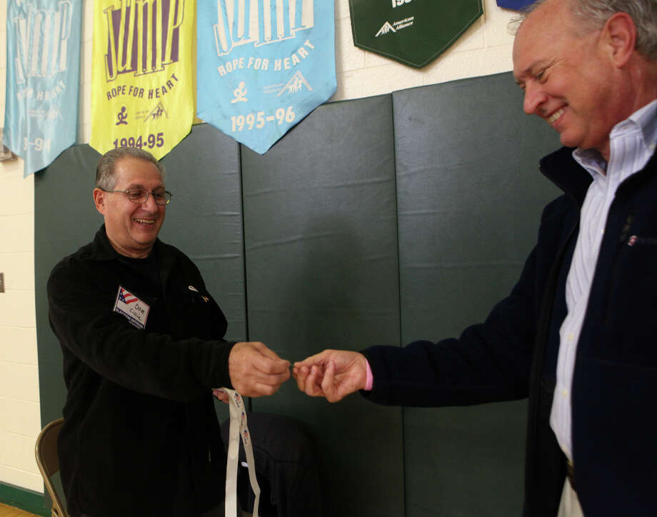 "Dom Ciccia hands out an ""I Voted"" sticker to Ed Turecek  at Mohegan School in Shelton, Conn. on Tuesday, Nov. 5, 2013. Photo: BK Angeletti, B.K. Angeletti / Connecticut Post freelance B.K. Angeletti"