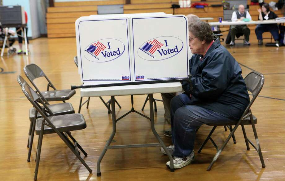 Voters can sit or stand to vote at Hillcrest Middle School in Trumbull, Conn. on Tuesday, Nov. 5, 2013. Photo: BK Angeletti, B.K. Angeletti / Connecticut Post freelance B.K. Angeletti