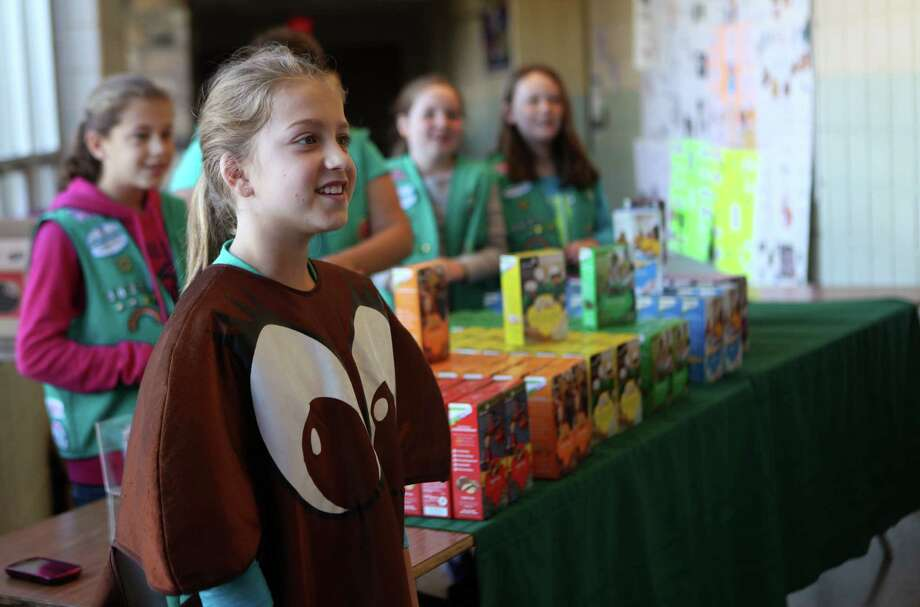 Girl Scout Bailey Cenatiempo, 10, and fellow FrenchTown Troop 36275 scouts sell cookies at Hillcrest Middle School in Trumbull, Conn. on Tuesday, Nov. 5, 2013. Photo: BK Angeletti, B.K. Angeletti / Connecticut Post freelance B.K. Angeletti