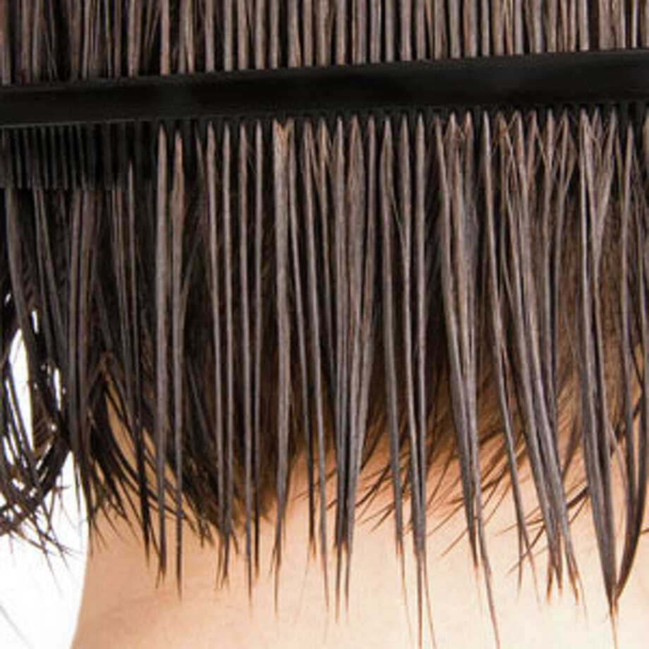"""Mistake: Not drying your hair enough before using a tool such as a round brush.""""The bristles on the brush are not designed to run through soaking wet hair, and the concentrated heat of the blow dryer right on wet hair can be damaging,"""" says Sarah Pozefsky, hair stylist at Complexions Spa for Beauty and Wellness.Instead, power dry hair to remove about 75 percent of the moisture before using the round brush.Source:HealthyLife magazine Photo: Joe Belanger/iStock, IStock"""