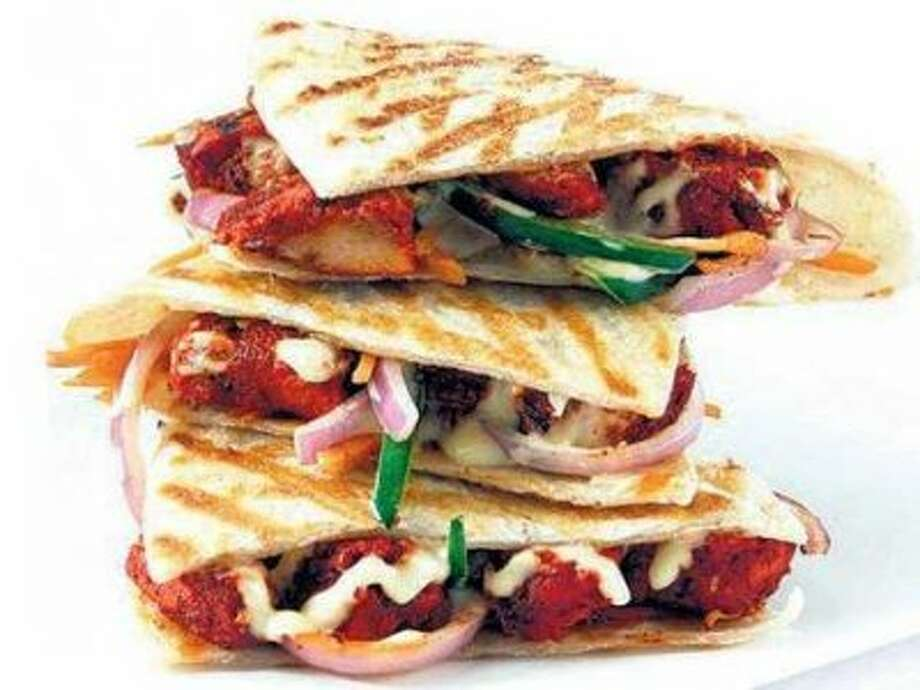 Kaati Zone  Country: India  Why it's great: Kaati offers more than a dozen types of rolls for meat-eaters and vegetarians alike.  Signature menu item: The Chicken Shami Kebab Roll with minced chicken and chick peas. www.kaatizone.com Photo: Courtesy