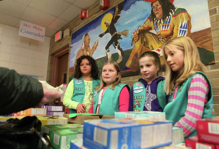 Troop 63140 Girl Scouts sell cookies at Mohegan School in Shelton, Conn. on Tuesday, Nov. 5, 2013. Photo: BK Angeletti, B.K. Angeletti / Connecticut Post freelance B.K. Angeletti