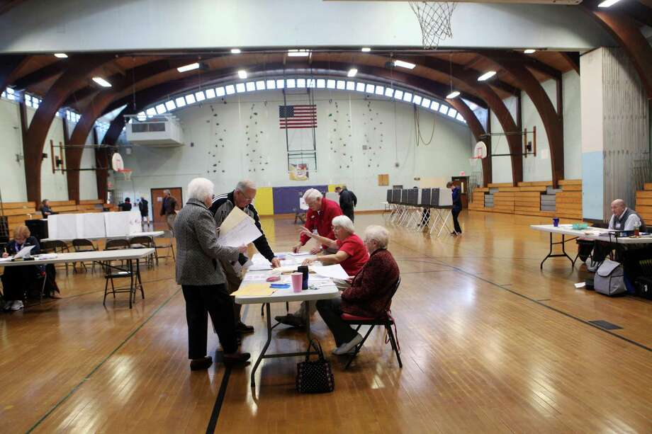 Voters check in at Hillcrest Middle School in Trumbull, Conn. on Tuesday, Nov. 5, 2013. Photo: BK Angeletti, B.K. Angeletti / Connecticut Post freelance B.K. Angeletti