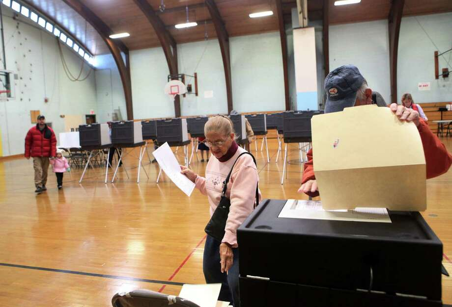 Voters cast their ballots at Hillcrest Middle School in Trumbull, Conn. on Tuesday, Nov. 5, 2013. Photo: BK Angeletti, B.K. Angeletti / Connecticut Post freelance B.K. Angeletti