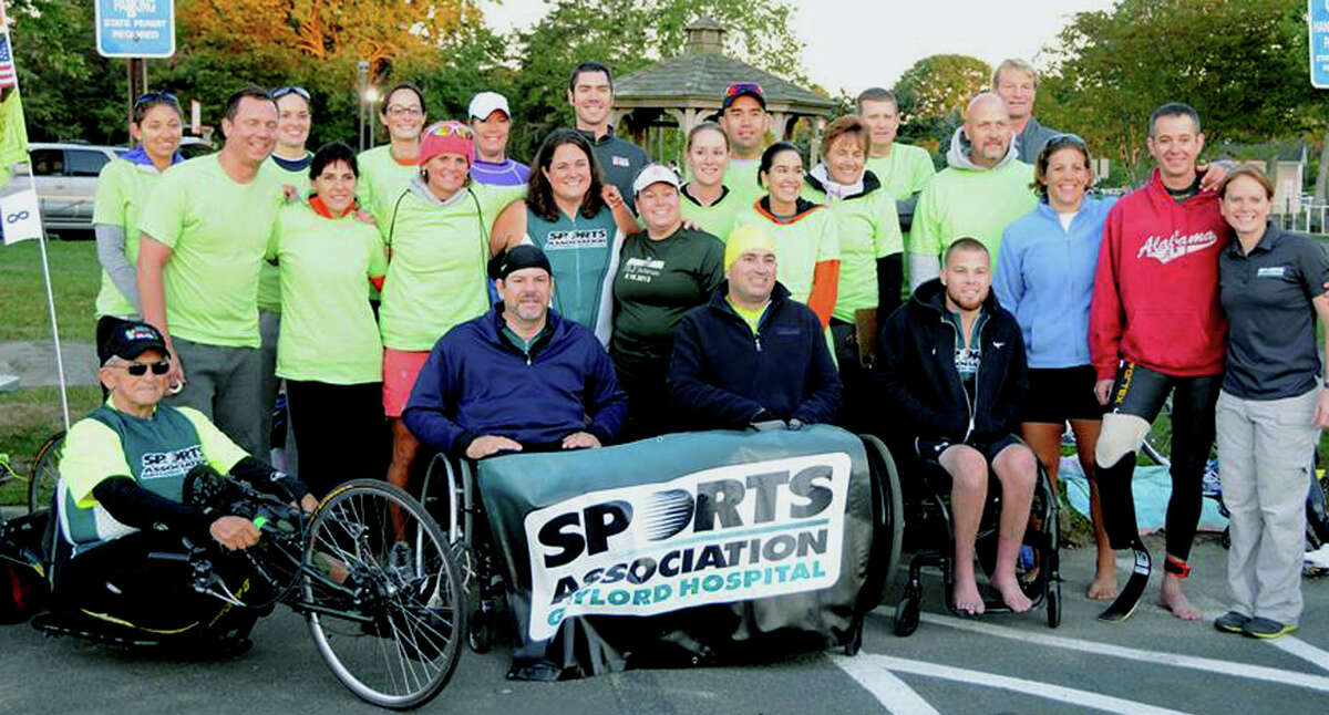New Milford's Tony Alllegretti, 70, left, poses with friends, staff and fellow athletes from the sports association representing Gaylord Hospital in Wallingford. Courtesy of Tony Allegretti
