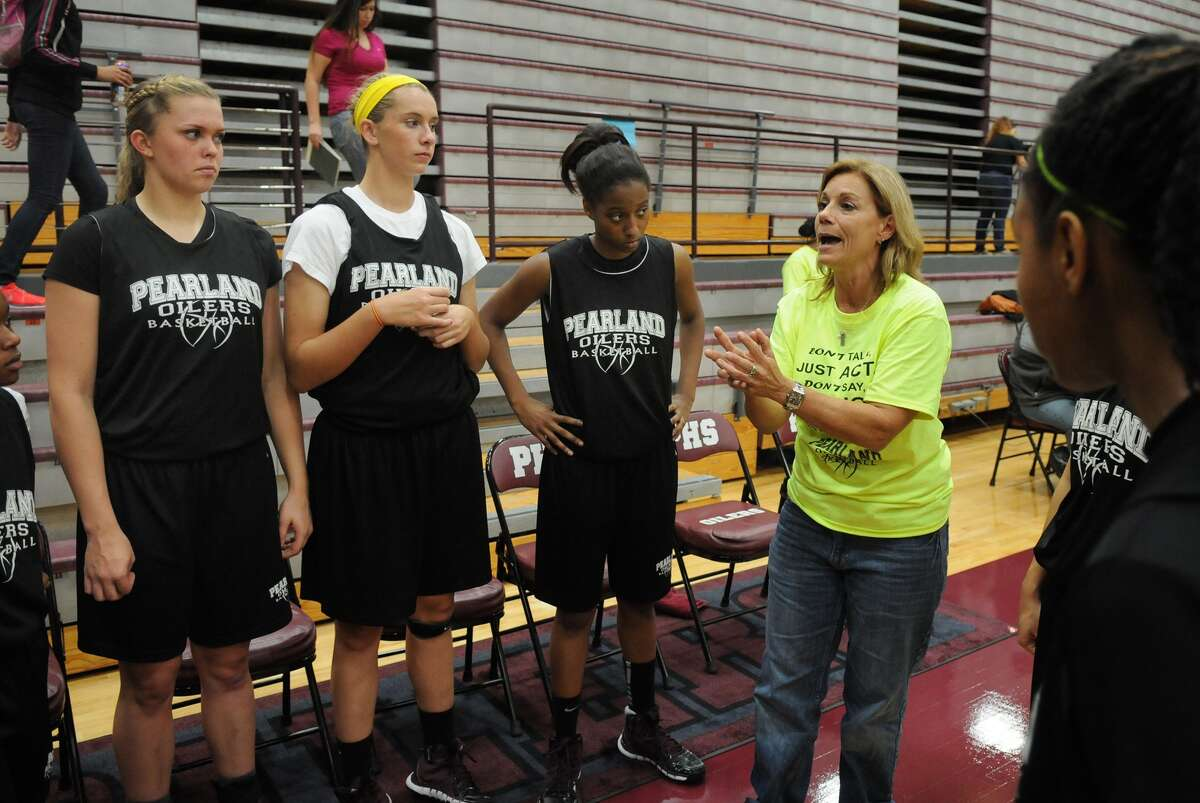 Pearland players Samantha Show, from left, Alyssa Denham, and Taylor James listen to Coach Donna Vacek during a break between scrimmages.