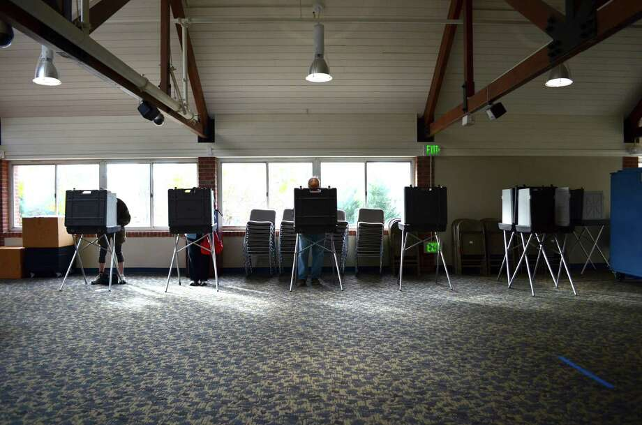 Shortly after 9 a.m. at 35 Leroy Ave., more than 100 members of District I had cast their votes for the municipal elections. Frank Kemp, the moderator, said 10 percent of the 2,000 District I were expected to vote by 8 p.m. Photo: Megan Spicer / Darien News