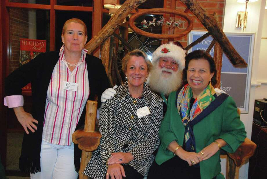 More than 60 New Canaan Chamber of Commerce members met at Bankwell's Elm Street branch Oct. 30 to plan the upcoming Holiday Stroll. Participating in the planning were, Bankwell Vice President and Branch Manager Gail Donovan, center, with Laura Budd of the chamber, left and Pam Pagnani. Santa also paid an early visit. Photo: Contributed Photo, Contributed / New Canaan News Contributed