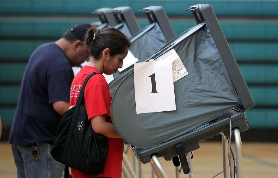 Voters at the Denver Harbor Park Community Center Tuesday, Nov. 5, 2013, in Houston.  ( James Nielsen / Houston Chronicle ) Photo: James Nielsen, Houston Chronicle