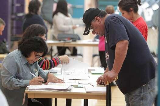 Ben Coronado signs in to vote at the Denver Harbor Park Community Center Tuesday, Nov. 5, 2013, in Houston.  ( James Nielsen / Houston Chronicle ) Photo: James Nielsen, Houston Chronicle