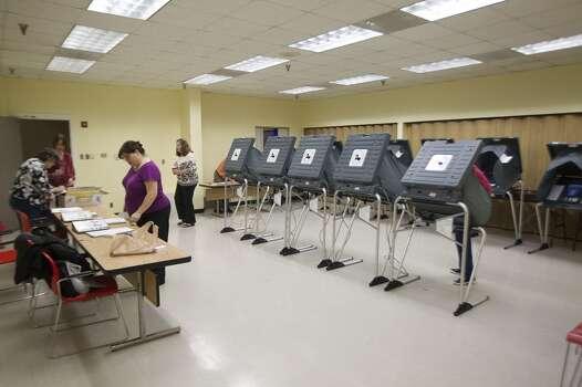 Election day volunteers prepare before voting began at the Metropolitan Multi-Service Center Tuesday, Nov. 5, 2013, in Houston. ( Johnny Hanson / Houston Chronicle ) Photo: Johnny Hanson, Houston Chronicle