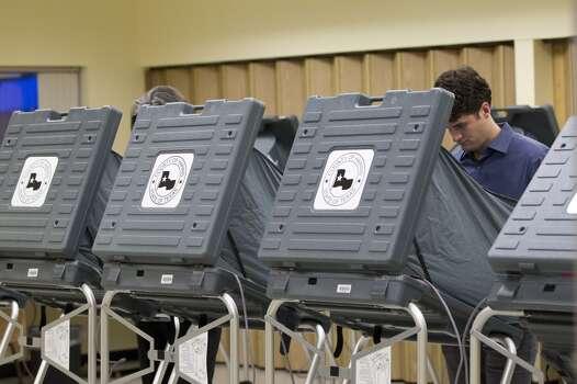 Tom Mysz votes at the Metropolitan Multi-Service Center Tuesday, Nov. 5, 2013, in Houston. ( Johnny Hanson / Houston Chronicle ) Photo: Johnny Hanson, Houston Chronicle