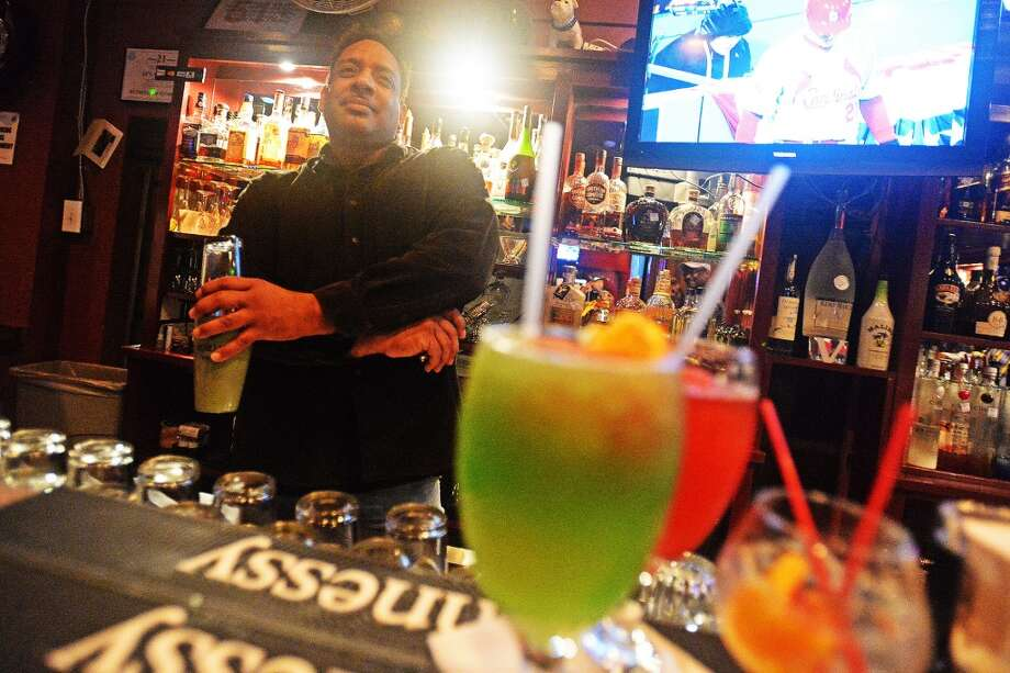 John Duplechain is known for his drink making abilities as well as helping to entertain the crowd while bar tending at Nell's place. Michael Rivera/The Enterprise