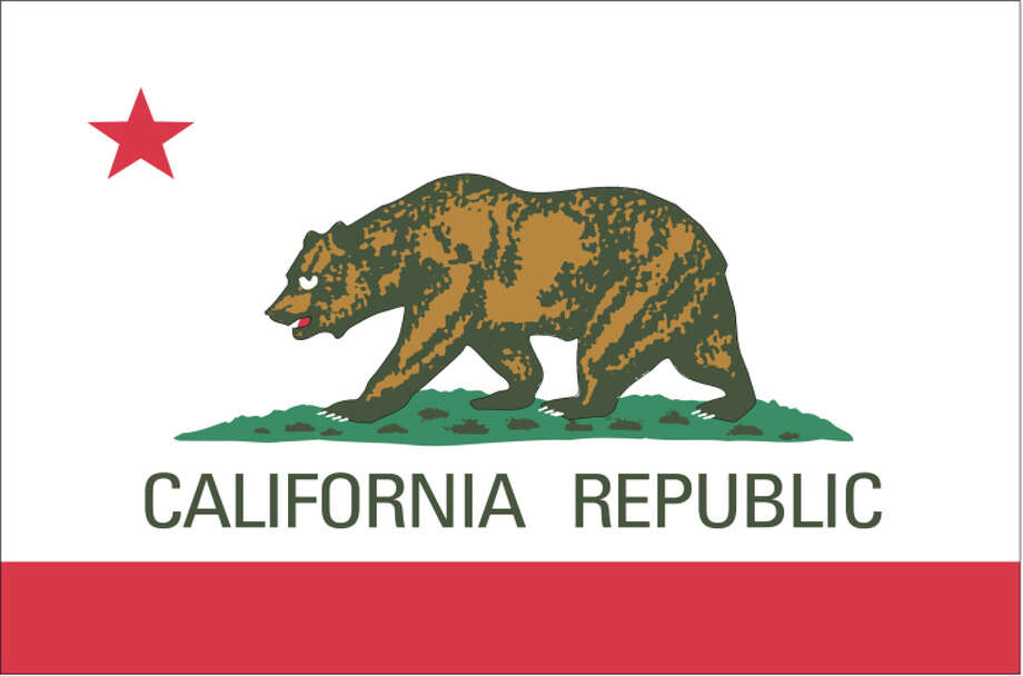 """California flag:Industrial designer Ed Mitchell has redesigned each of the flags of the states in the union to make them each carry a unified design across all 50 states.Why? They didn't look like they belonged together.""""When you look at them all together, there's no indication they come from the same nation,"""" he said.Mitchell, who works for product design firm Bresslergroup in   Philadelphia, took a look at the flags of all 50 states and was bothered   by the lack of a blanket design scheme. """"Discordant"""" was how he   described them as a group on the project's website. They also broke   every rule of flag design. Yes, there are rules to flag design.Those rules include simplicity (meaning a child could draw it from   memory), relevant symbolism, no more than three basic colors, no text or   seals, and a distinctive look that doesn't ape other flags.Mitchell set about unifying color and proportion across all fifty   flags, using a vibrant red, white, and blue for each, while retaining   some sense of symbolism for each.The best flags in the union — Texas, California, Wyoming, and Washington — only have a passing glimmer of their former selves. Click to see the one proposed for California.  Photo: Globe Turner, LLC, Getty Images/GeoNova Maps / GeoNova Maps"""