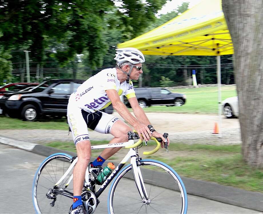 Riders from Aetna Healthcare's pro cycling team, like this one, served as marshals in 2012's CT Challenge Bike Ride. CT Challenge will benefit from a Band Together concert in Fairfield on Nov. 8, 2013. Photo: Mike Lauterborn