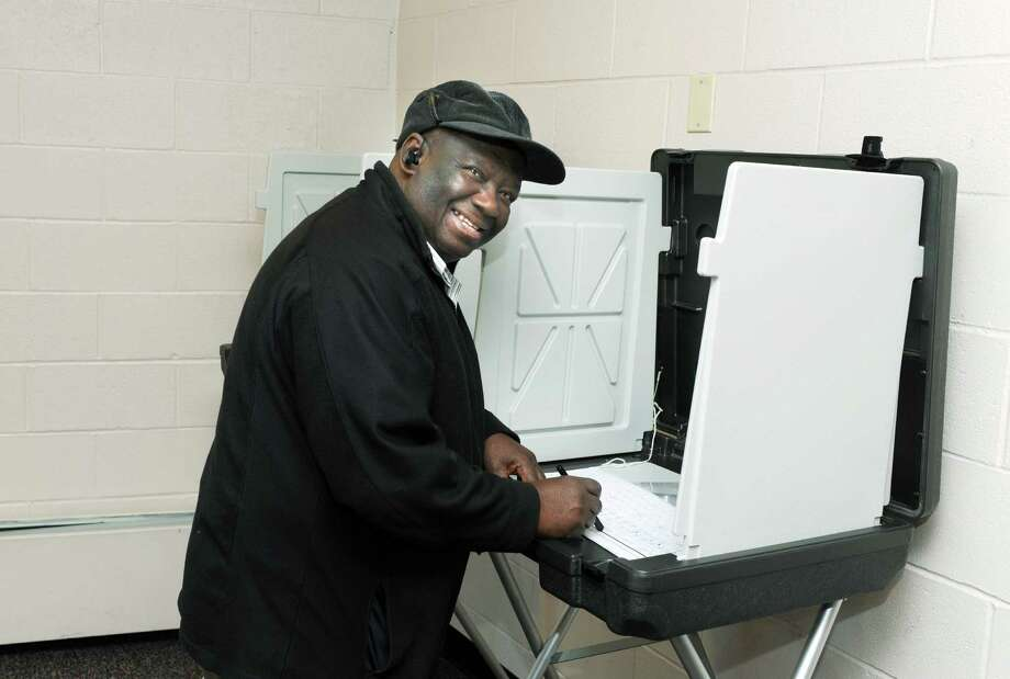 Sony Jean-Louis votes at Westover School in Stamford, Conn. on Tuesday November 5, 2013. Photo: Dru Nadler / Stamford Advocate Freelance