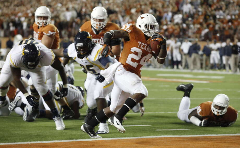 Last season Joe Bergeron all the UT rushing rage.  This season only as many TDs as defensive menace Chris Whaley. Photo: Michael Ainsworth, Staff Photographer / 10015659A
