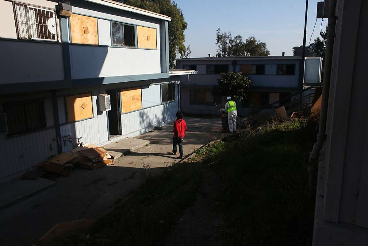 """A high school student who gave his name as """"Jay"""" wanders through the old portion of the Hunters View community during pre-demolition cleanup on October 30, 2013 in San Francisco, Calif. The portion of the housing project south of West Point Road and west of Middle Point Road is currently being dismantled."""