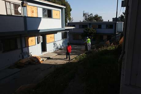 "A high school student who gave his name as ""Jay"" wanders through the old portion of the Hunters View community during pre-demolition cleanup on October 30, 2013 in San Francisco, Calif. The portion of the housing project south of West Point Road and west of Middle Point Road is currently being dismantled."