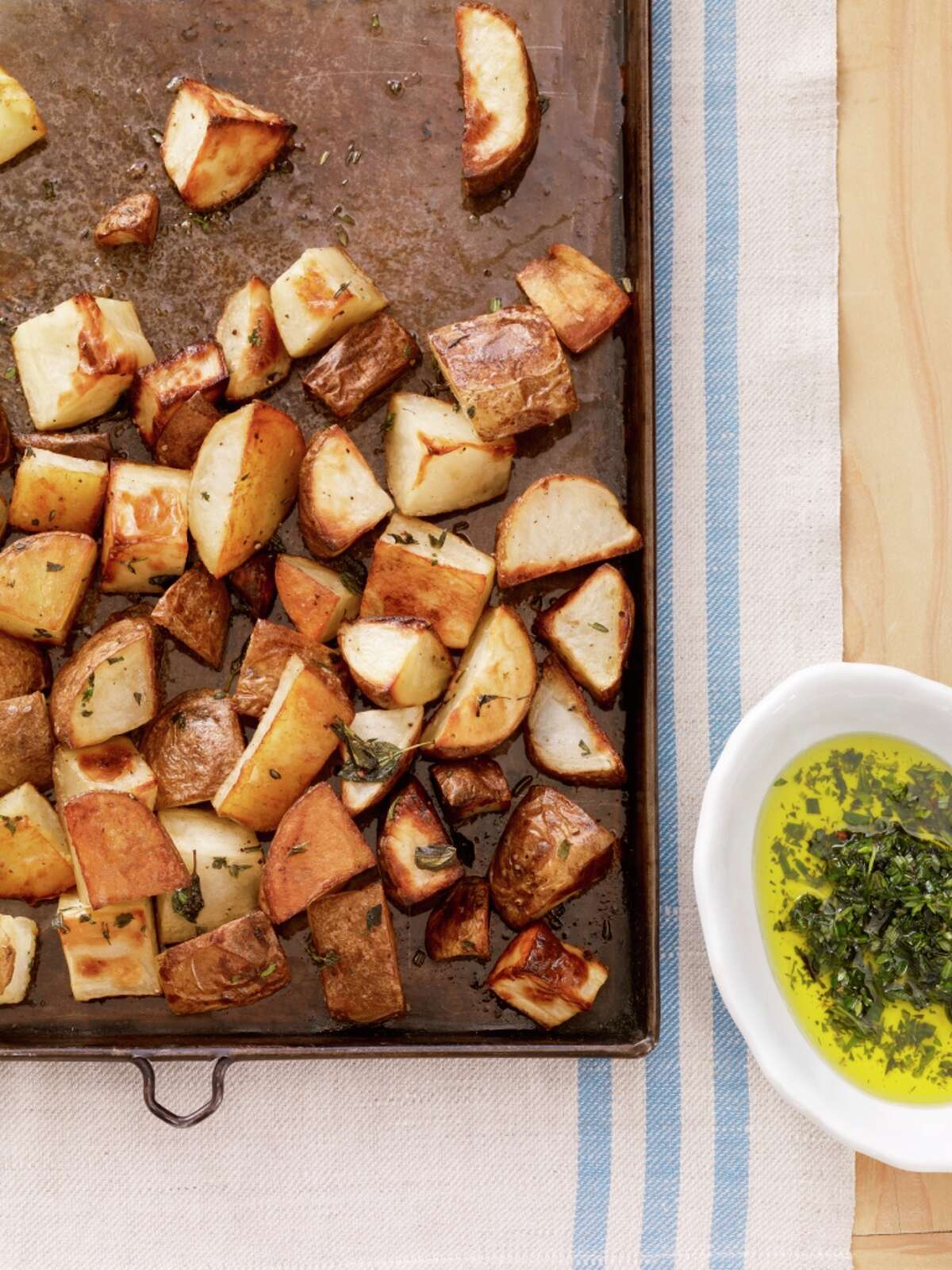 Delish: Country Living recipe for Roasted Potatoes with Fresh Herbs.