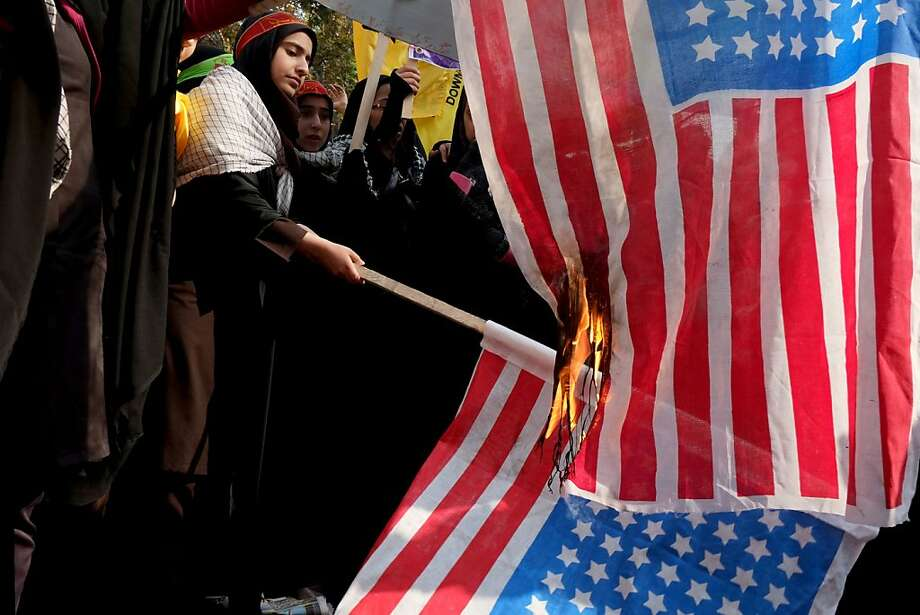 Iran, which never seems to run out of combustible American flags,marks the 34th anniversary of the 1979 takeover of the U.S. embassy in Tehran with impromptu banner burnings. Thousands packed the streets to commemorate the Islamist students who stormed the embassy compound and held 52 American diplomats hostage for 444 days. Photo: Majid Saeedi, Getty Images