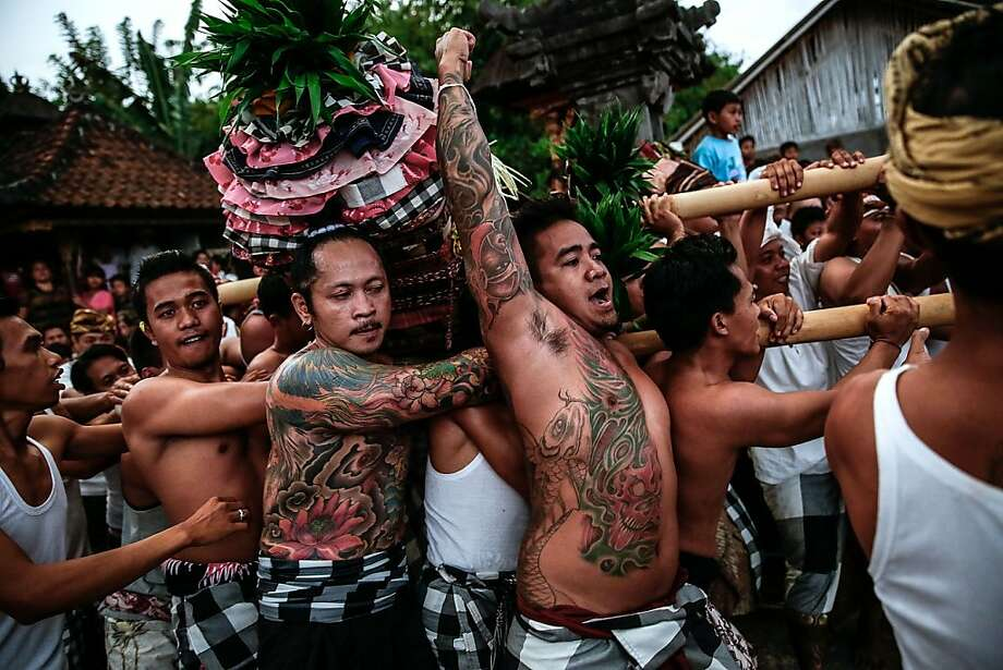 Litter jousting:Palanquin bearers carrying effigies of the gods ram other palanquins in the climax of the Dewa Masraman Ritual in Klungkung Regency, Bali. The litter-bearing teams rush around the temple in a trance-like state, crashing into each other like Bumper Cars. Photo: Agung Parameswara, Getty Images