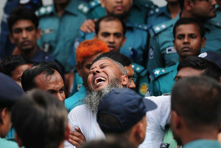 The ultimate price for his crime: A Bangladesh Rifles soldier reacts as he is sentenced to death for mutiny at a special court in Dhaka. About 150 others will share his fate for a 2009 military mutiny that left scores of top officers massacred. Photo: Munir Uz Zaman, AFP/Getty Images