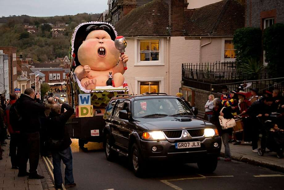 An immature effigy of North Korea's Kim Jong Un is paraded ahead of Bonfire Night celebrations Thursday in Lewes, England. Every Nov. 5, Britons celebrate the Gunpowder Plot, an unsuccessful attempt by Guy Fawkes to blow up the Houses of Parliament in 1605, by lighting bonfires across the country. Photo: Leon Neal, AFP/Getty Images