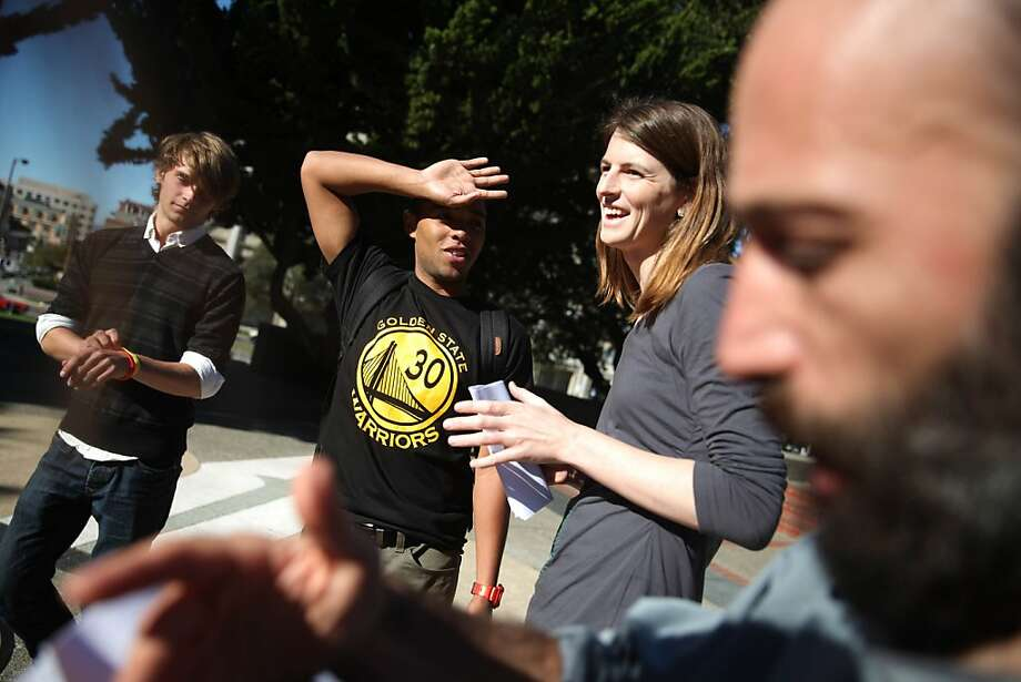 Joey Ward (left), a UC Berkeley freshman; Toure Owen, a UC Berkeley junior; Amanda Armstrong, a UC Berkeley grad student; and Josh Brahinsky, a UC Santa Cruz grad student, talk at a news conference at Cal. Photo: Lea Suzuki, The Chronicle