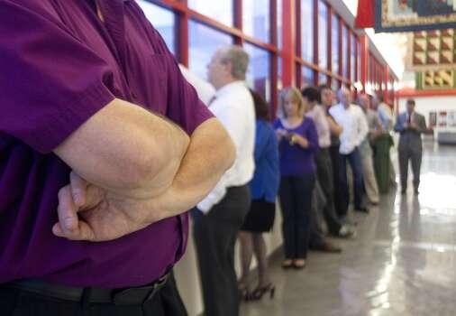 Voters  queue up at the Metropolitan Multi-Service Center Tuesday, Nov. 5, 2013, in Houston. ( Johnny Hanson / Houston Chronicle ) Photo: Johnny Hanson, Houston Chronicle