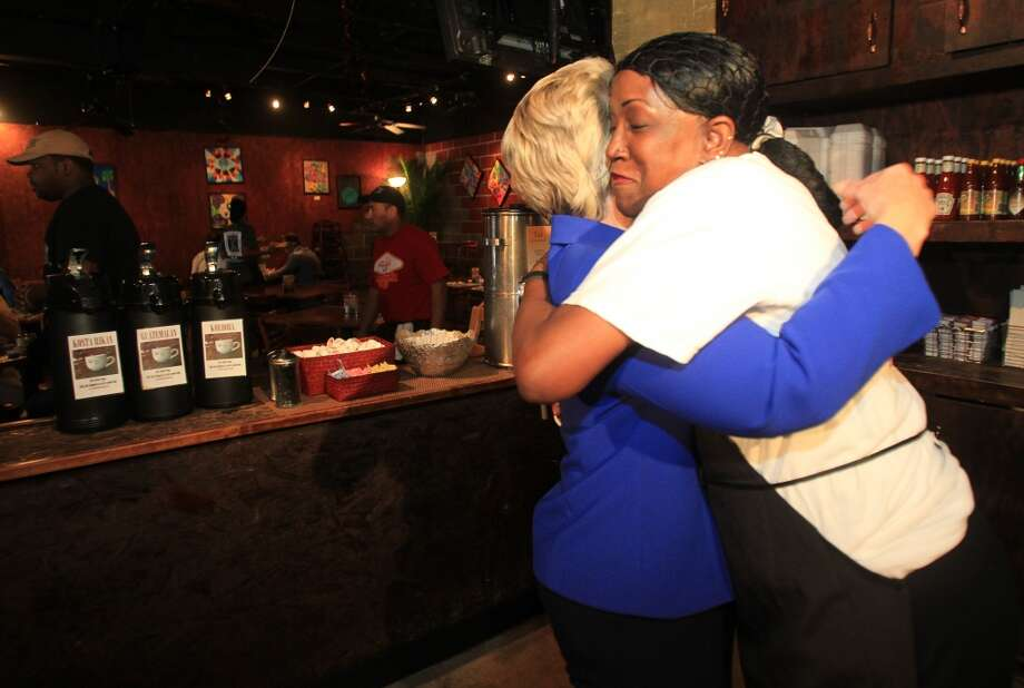 Jacquelyn McKnight embraces Mayor Annise Parker as she starts Election Day at The Breakfast Klub on Tuesday, Nov. 5, 2013, in Houston.  ( Mayra Beltran / Houston Chronicle ) Photo: Mayra Beltran, Houston Chronicle