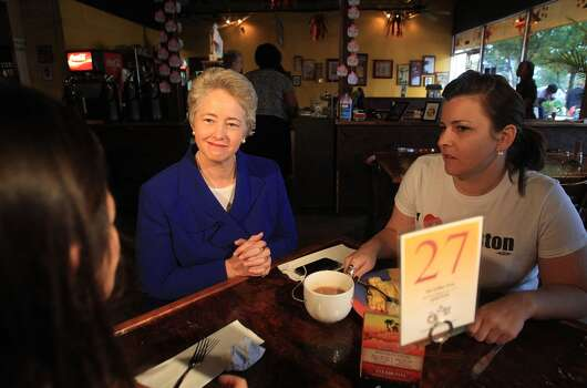 Emmy Ruiz and Lillie Schechter speak with Mayor Annise Parker over breakfast as she starts Election Day at The Breakfast Klub on Tuesday, Nov. 5, 2013, in Houston.  ( Mayra Beltran / Houston Chronicle ) Photo: Mayra Beltran, Houston Chronicle
