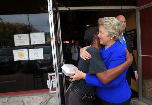 Employee Mary Jackson gives Mayor Annise Parker a goodbye hug as she leaves The Breakfast Klub on Election Day on Tuesday, Nov. 5, 2013, in Houston.  ( Mayra Beltran / Houston Chronicle ) Photo: Mayra Beltran, Houston Chronicle