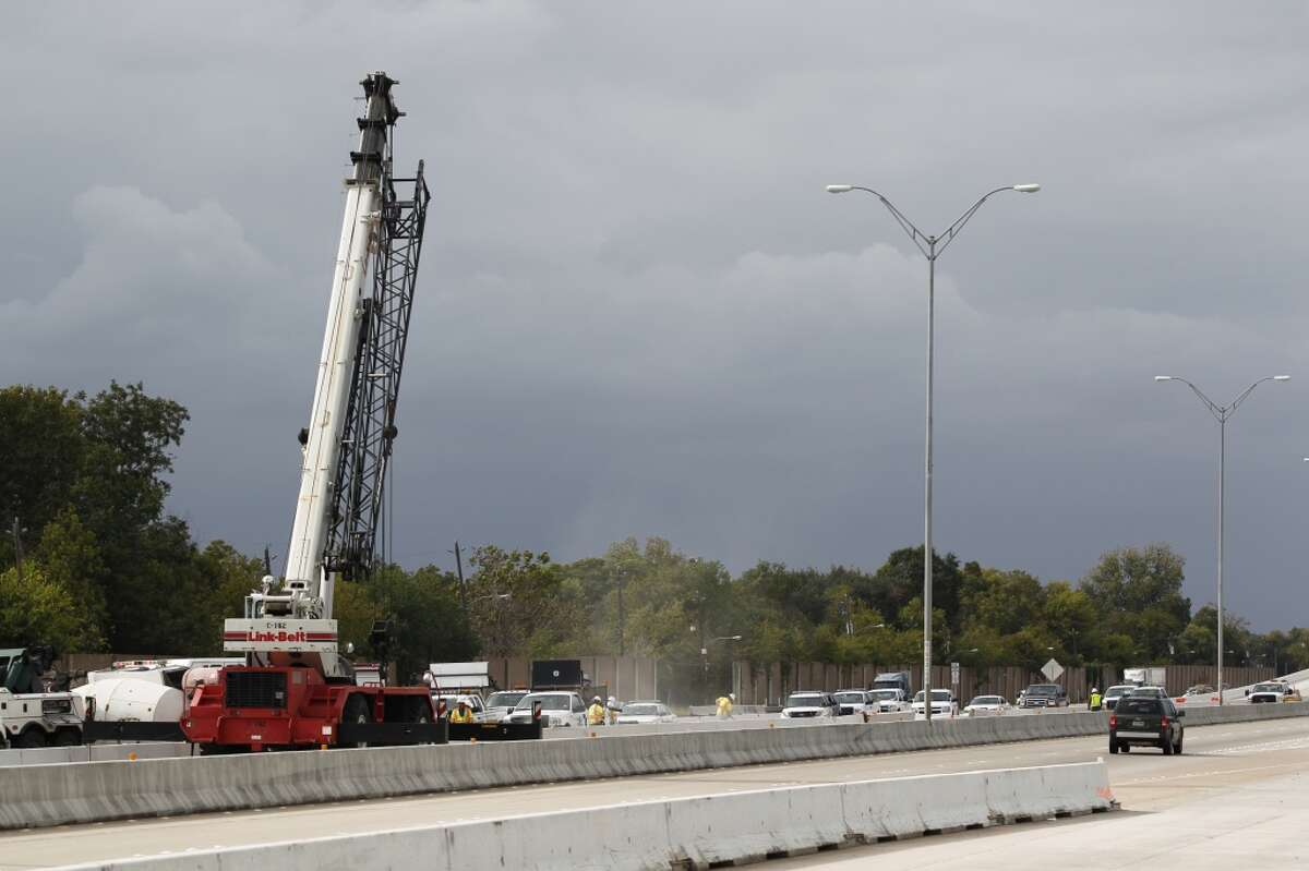 Portions of the Sam Houston Tollway are blocked after a cement truck overturned about 12:25 p.m. Tuesday on South Beltway 8 near Fuqua.