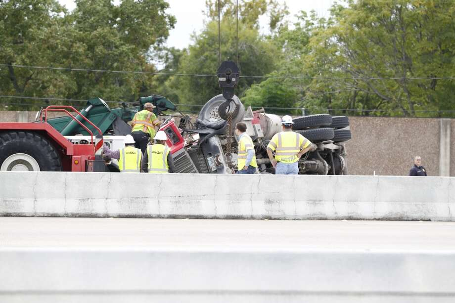 Portions of the Sam Houston Tollway are blocked after a cement truck overturned about 12:25 p.m. Tuesday on South Beltway 8 near Fuqua. Photo: Johnny Hanson, Houston Chronicle