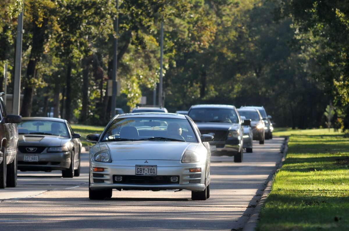 Kingwood Drive is nestled in a long and forested line of trees, some of which might be eliminated should the roadway be widened to six lanes, because of the rapid growth in the area and the corresponding increase in traffic.