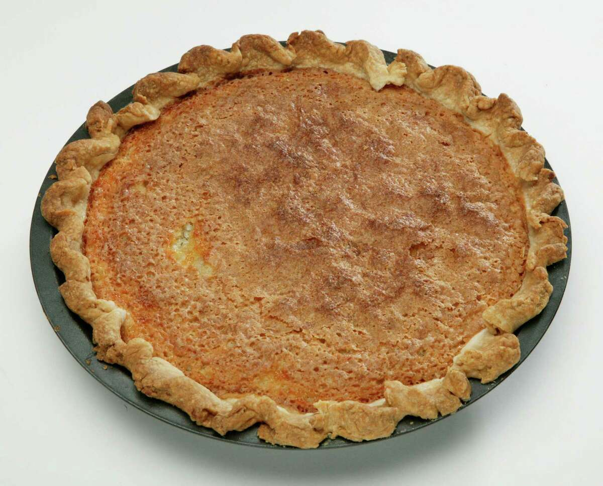2) Buttermilk pie - either pie with slice cut out or slice of pie on small plate, which ever looks best. Whole Pie unsliced (AC Studios for the Chronicle)