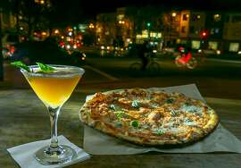 The Margarita Pizza with the Bourbon & Basil cocktail at the Orbit Room in San Francisco, Calif., is seen on November 4th, 2013.