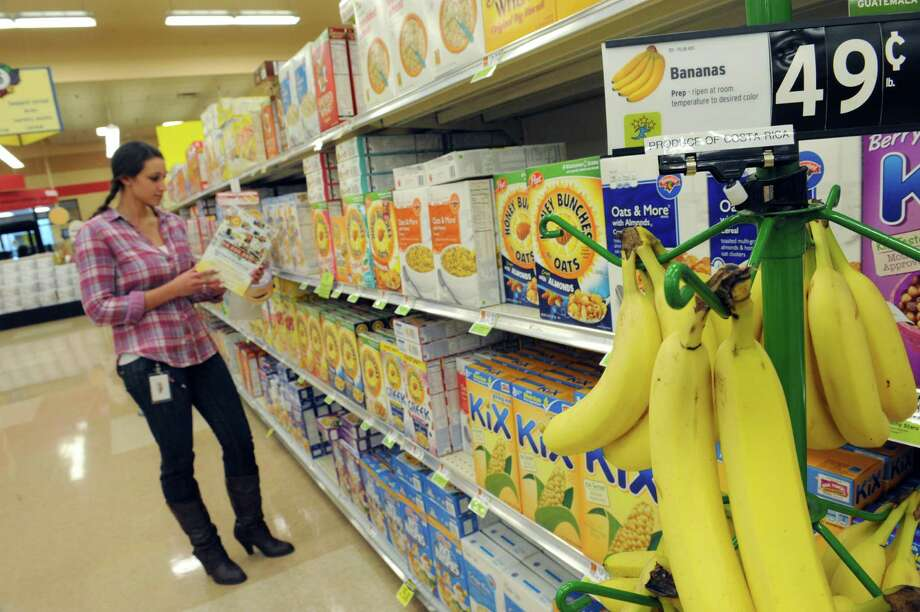 Danielle Browarski of Colonie shops in the cereal aisle at the Wolf Road Hannaford on Thursday Oct. 31, 2013 in Colonie, N.Y. (Michael P. Farrell/Times Union) Photo: Michael P. Farrell / 00024460A