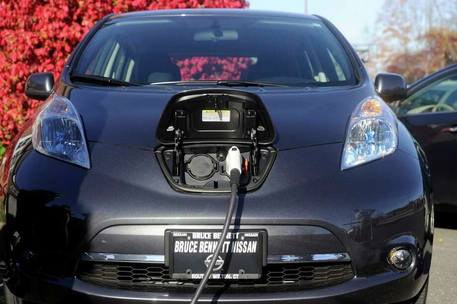 A town-owned electric car is charged at a charging station at the Ridgefield Playhouse in Ridgefield. Monday, Nov. 4, 2013. Photo: Carol Kaliff / The News-Times