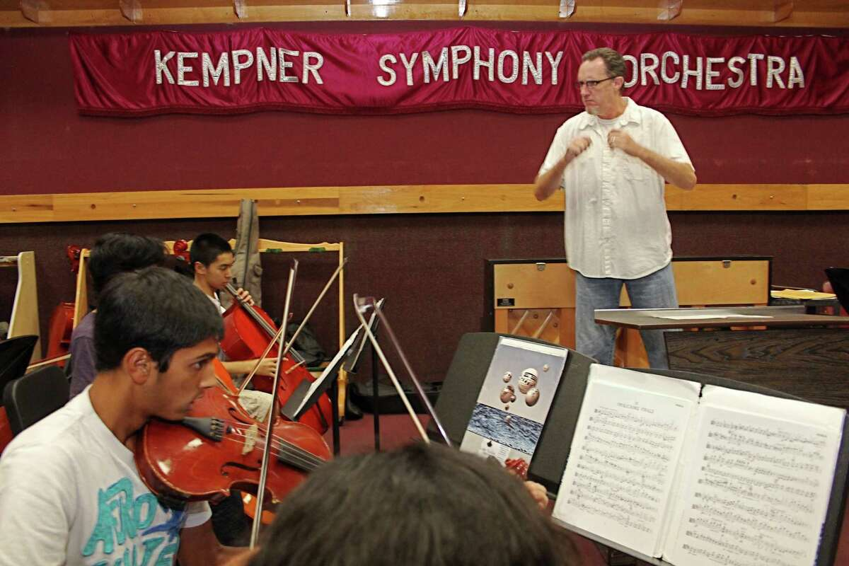 Kempner High School orchestra director Mike Wells leads students in practice for the orchestra's trip to Washington, D.C., June 3-6 to participate in the 70th anniversary of the Normandy invasion. Kempner High School orchestra director Mike Wells leads students in practice for the orchestra's trip to Washington, D.C., June 3-6 to participate in the 70th anniversary of the Normandy invasion.
