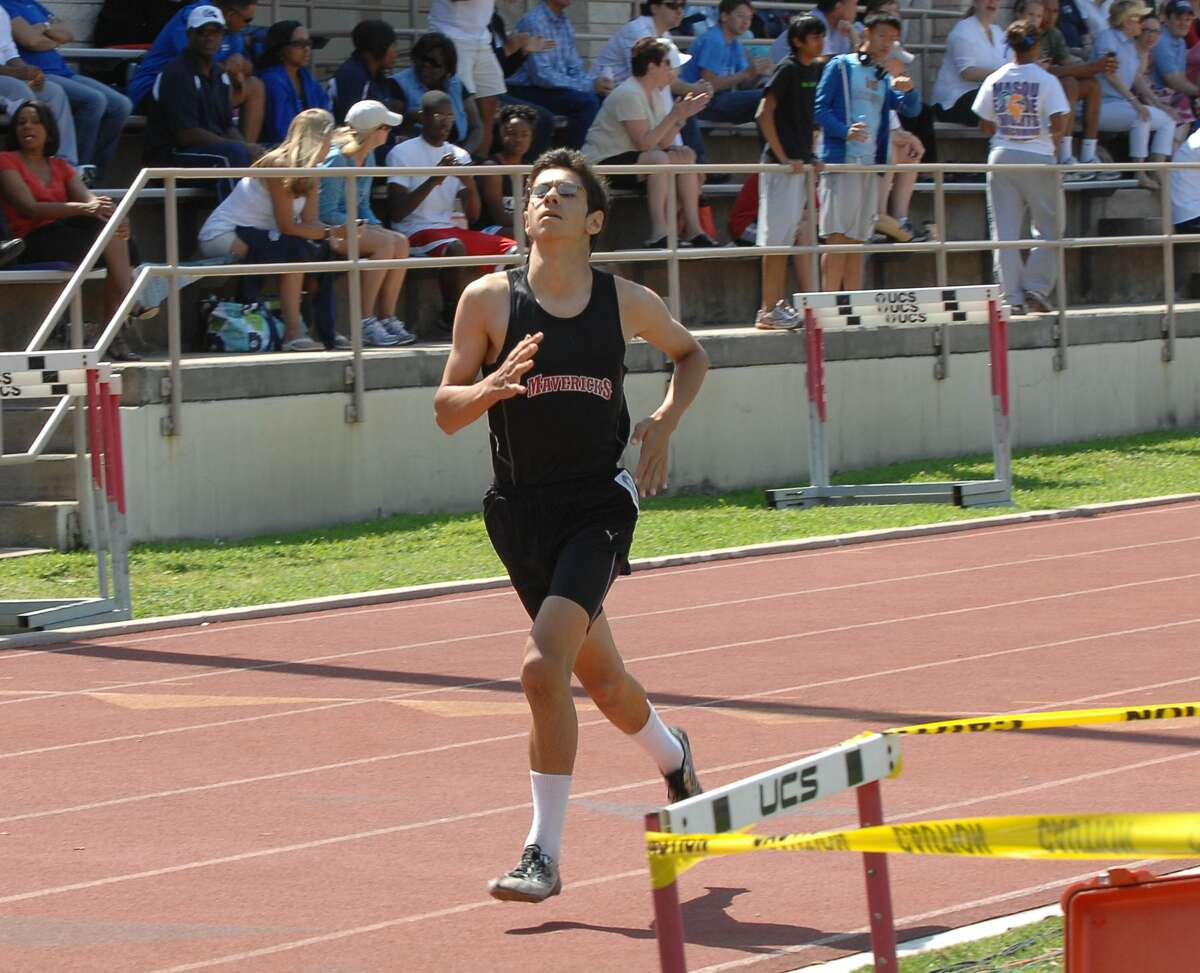 The Nick Finnegan Invitational Track Meet was held Saturday, April 16, 2011, at The St. Johns School. Xavier Gonzalez of St. John's crosses the finish line first in the boys 800 meter run with a time of 2:06:55. Photo Eddy Matchette