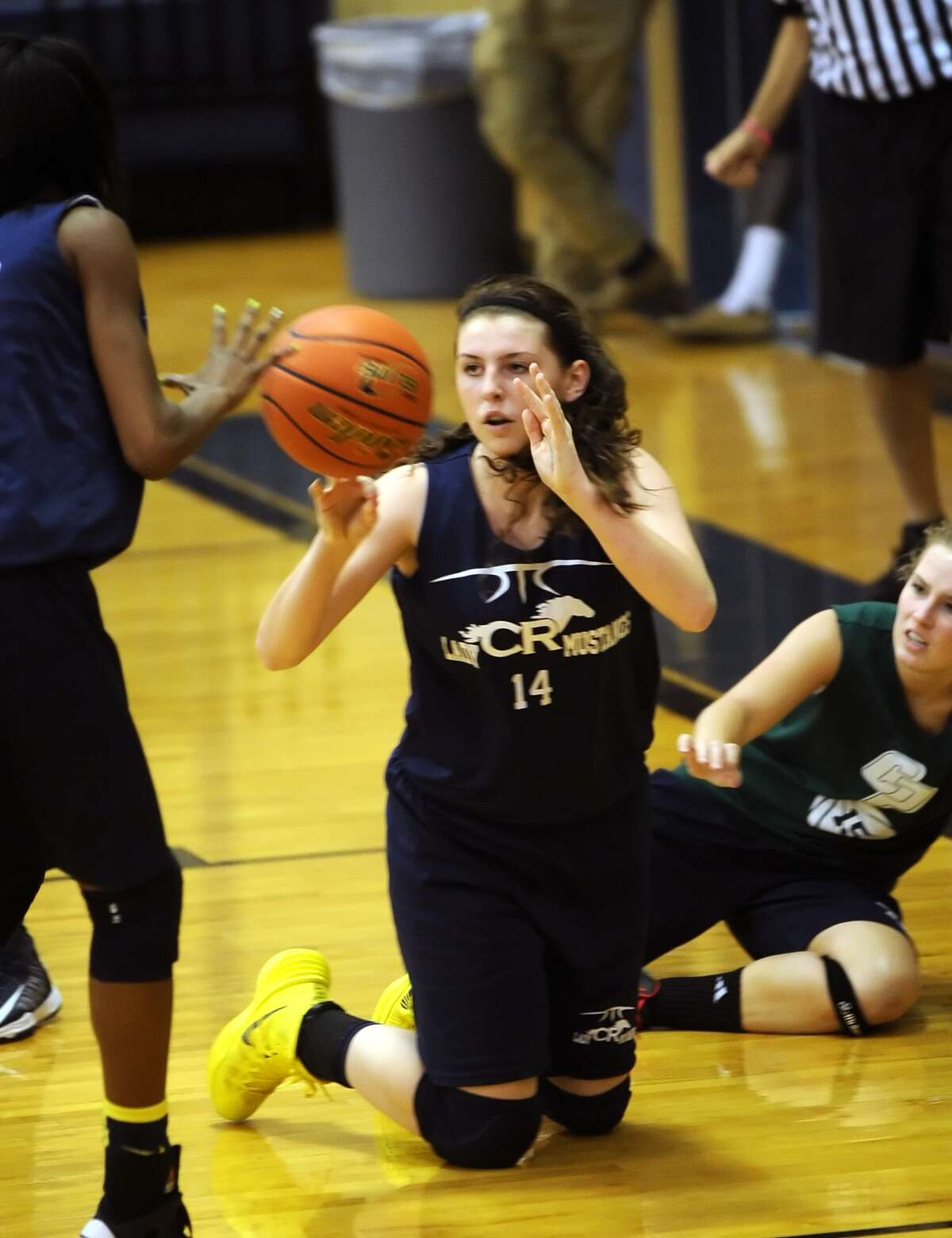 Cy Ranch and College Park girls basketball teams played a game at Cy Ranch High School as part of a three team scrimmage. Katie Roy (14) of Cy Ranch went to the floor to recover a loose ball against College Park.