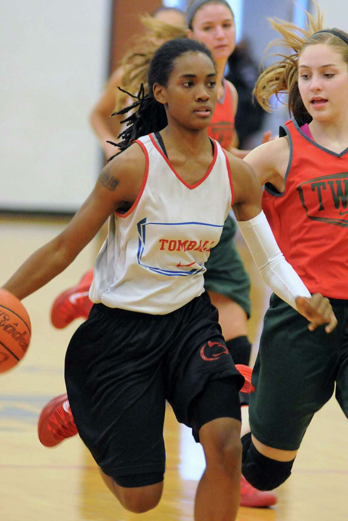 Tomball's Laisia Chisholm dribbled past a defender during a scrimmage against The Woodlands at Klein Collins High School.
