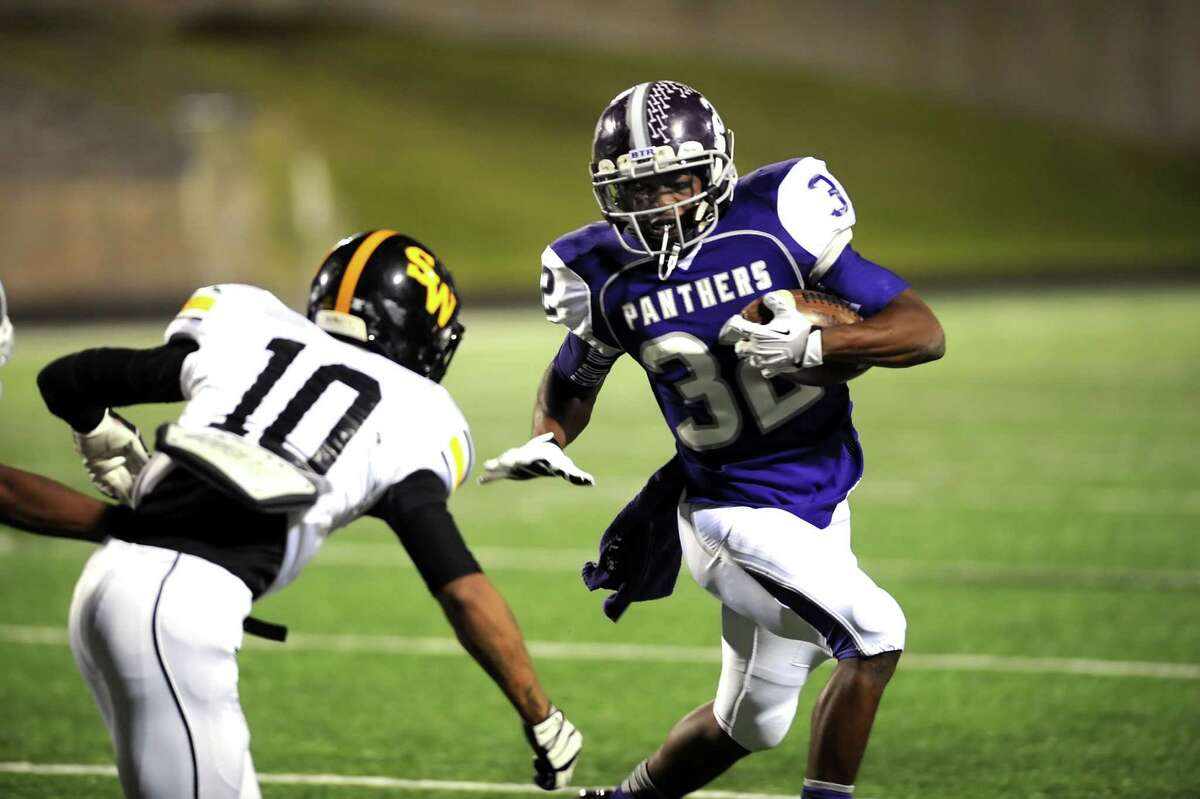 Ridge Point running back Reggie Taylor (32) uses a stiff arm to get around Spring Woods defensive back Rene Galicia (10) during the Panthers' 70-7 win last weekend.