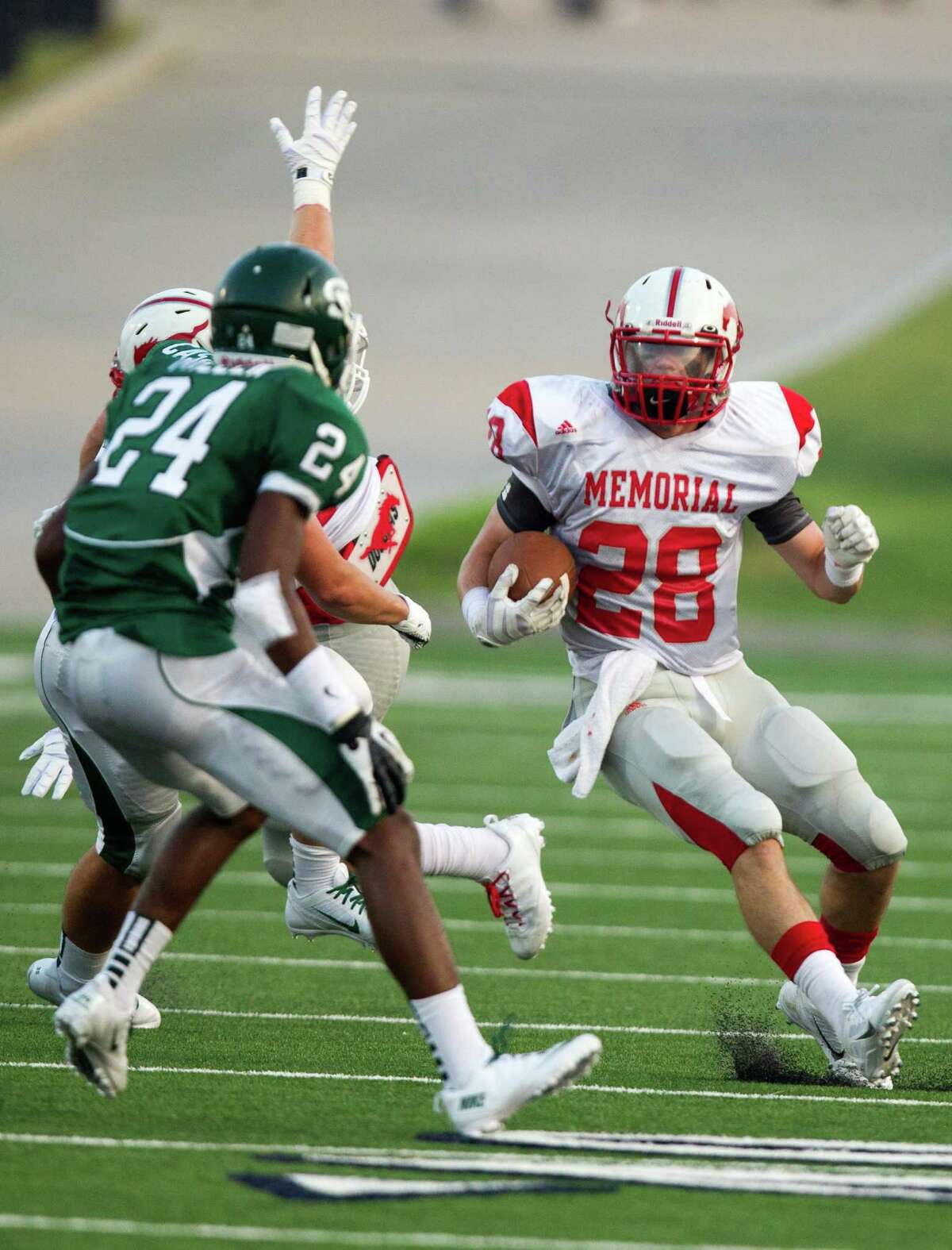 Memorial running back Matt Collins (28) runs past Stratford defensive back Zach Miller (24) during the first half of a high school football game at Tully stadium on Friday, Aug. 30, 2013, in Houston. ( J. Patric Schneider / For the Chronicle )